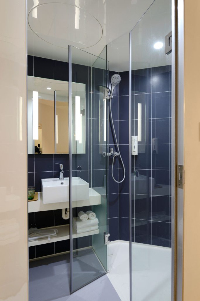 Glass shower enclosures make small bathrooms look larger