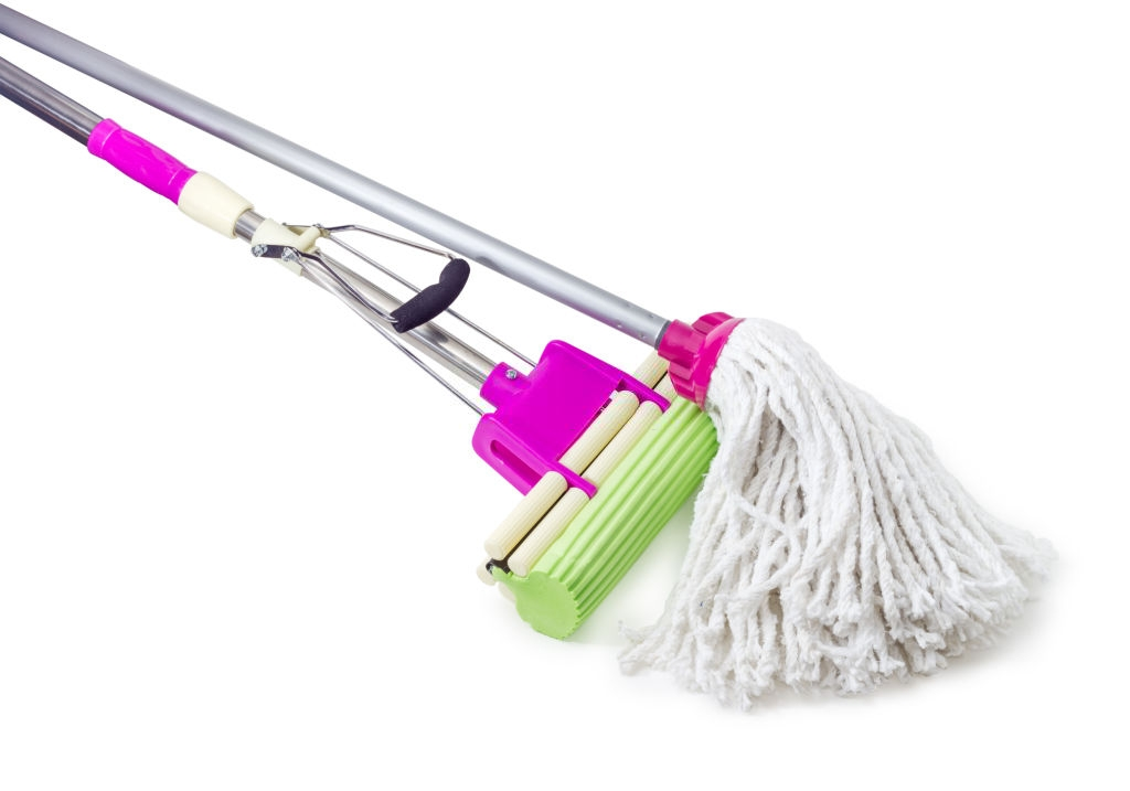 cleaning using mop with large stick
